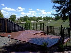 Hillside composite deck with rod iron railing. Rocklin, CA