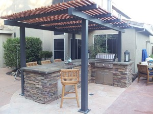 Outdoor Kitchen with matching fireplace